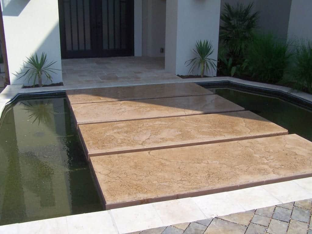 Tan Precast Concrete Panels Bridge over Water Pond