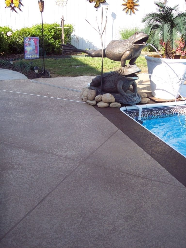 Dark Brown Pool Deck Concrete Overlay Photo