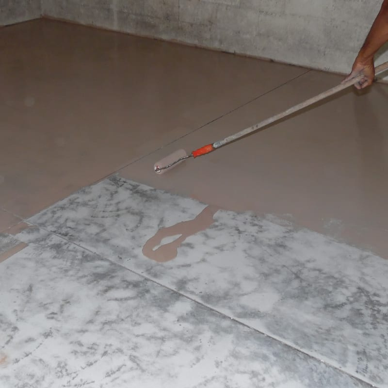 Rolling Out Primer Coat for Epoxy Flake Flooring in Garage